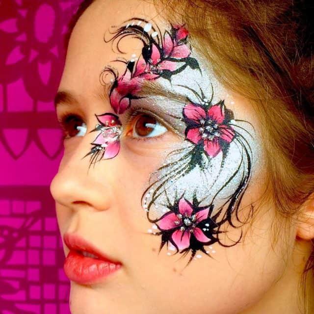 Pretty flowers and glitter face paint Festival eyes facepaint chunkyglitterhellip